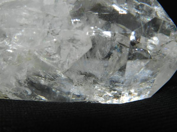 Close up of detailing and reflections on the tip of a Crackle Quartz