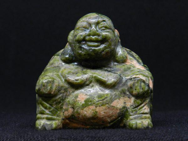 Close up image of a Unakite buddha