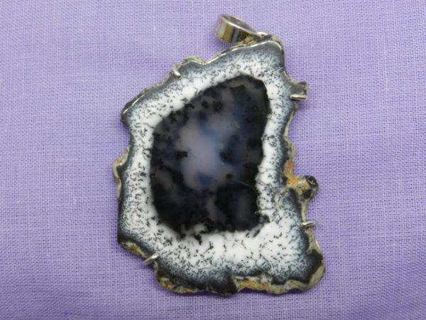 merlinite crystal pendant
