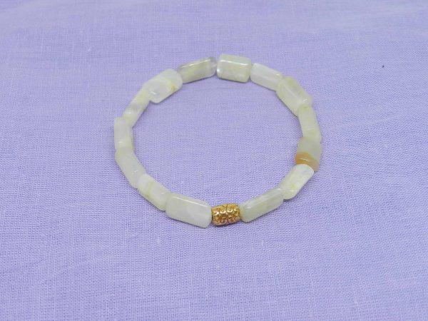 Moonstone with brass charm bracelet