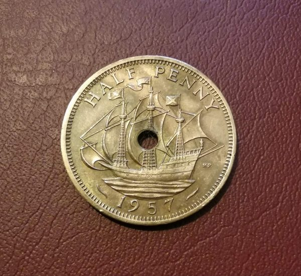 1957 half penny coin